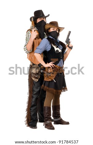 Couple of armed robbers in cowboy costumes. Isolated on white - stock photo