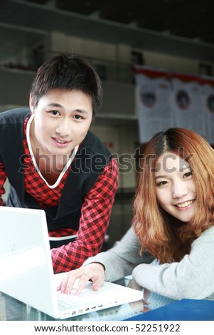 couple of asian using laptop
