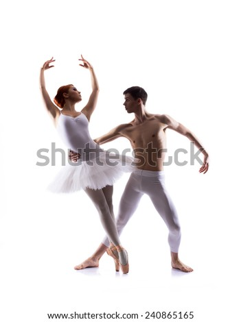 Couple of ballet dancers isolated on white - stock photo