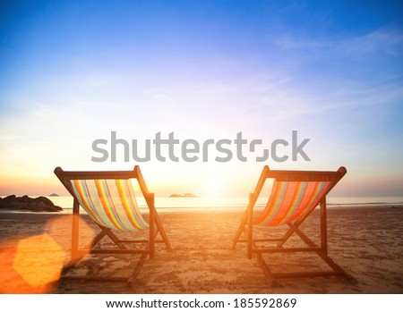Couple of beach chairs on sea coast. - stock photo