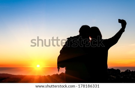 Couple of best friends taking selfie during sunset at Twin Peaks in San Francisco - Modern concept of friendship with new trends and technology - Travel girlfriends having emotional fun together  - stock photo