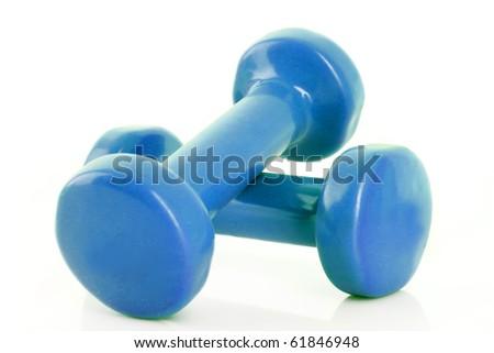 Couple of blue dumbbells isolated on white - stock photo
