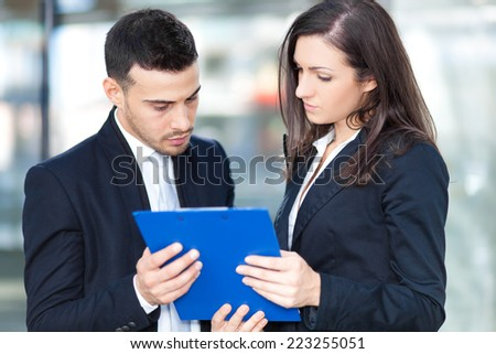 Couple of business people discussing outdoor - stock photo