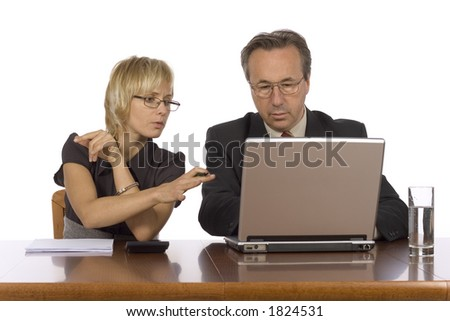 couple of businesspeople at the table with laptop - stock photo