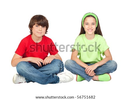 Couple of children sitting on a white background - stock photo