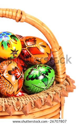 Couple of colorful Easter Eggs in wicker basket.