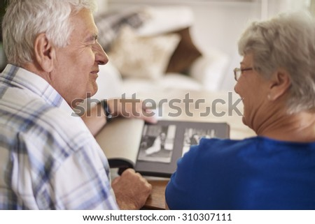 Couple of elder couple reminiscing their past - stock photo