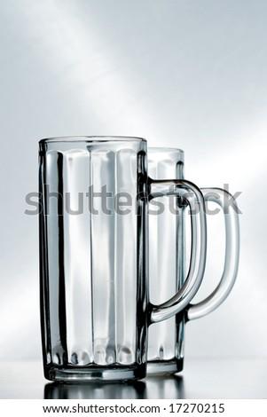 couple of empty beer glasses - stock photo