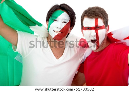 Couple of football fans looking happy with their faces painted - Isolated over white - stock photo