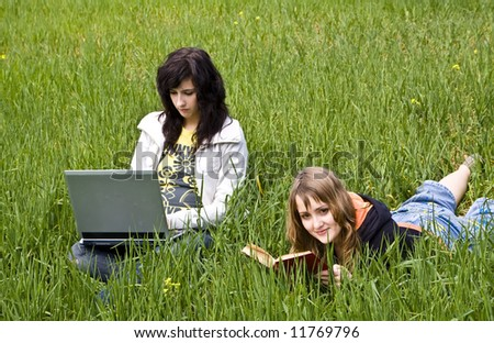 Couple of friends enjoying freetime at the meadow - stock photo