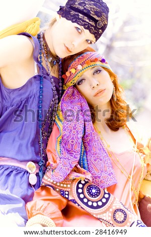 couple of girlfriends in colorful clothes enjoy in summer day - stock photo