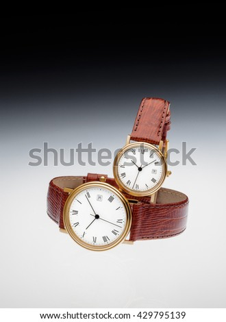 couple of gold watches for woman and for man together