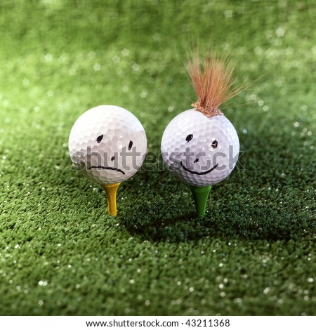 couple of golf ball characters on grass - stock photo