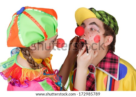 Couple of happy clowns isolated on white background - stock photo