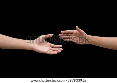 couple of helping/praying hand black background,support/ aid/love/trust / healthcare/ therapy/healing /affection / friends and family concept. - stock photo