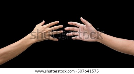 couple of helping/praying hand while background,support/ aid/love/trust / healthcare/ therapy/healing /affection / friends and family concept.