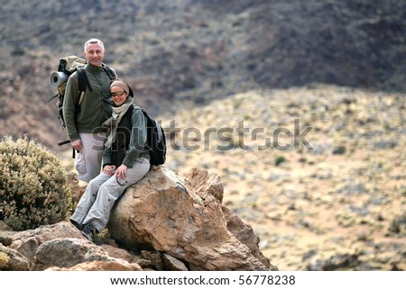 Couple of hikers - stock photo