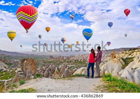 Couple of hikers enjoying valley view in Cappadocia, Turkey, - stock photo