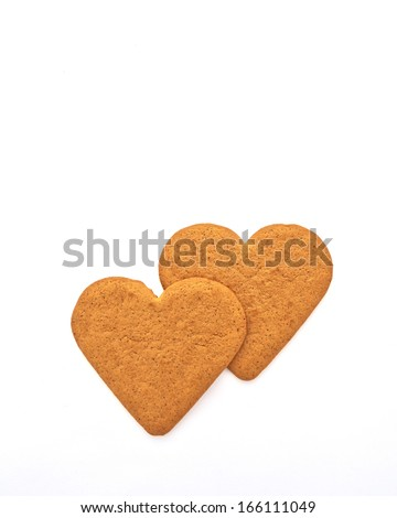 couple of homemade sweethearts on white - stock photo