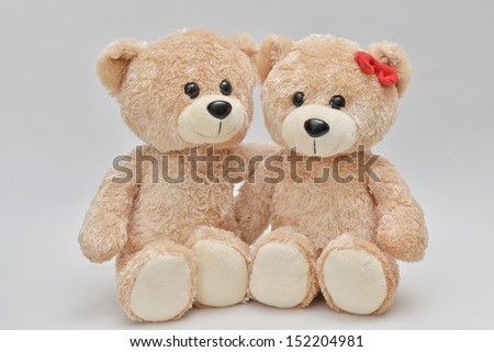 Couple of light brown teddy bear on white background - stock photo