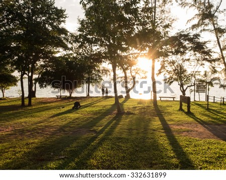 Couple of love taken photo when sunrise with long shadow - stock photo