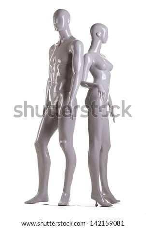 Couple of male and a female fashion mannequin on white background - stock photo