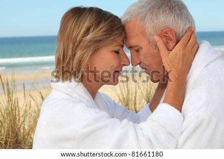 couple of mature people meditating - stock photo