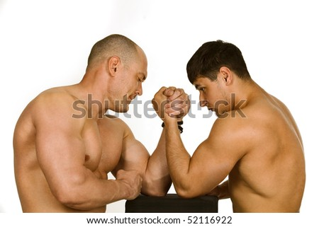 Couple of muscular men measuring forces, isolated on white - stock photo