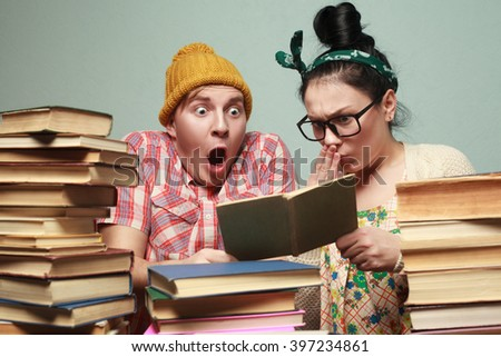 Couple of nerd students learning - stock photo