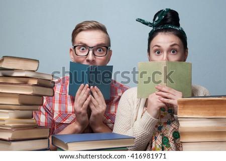 Couple of nerd students preparing to exam - stock photo