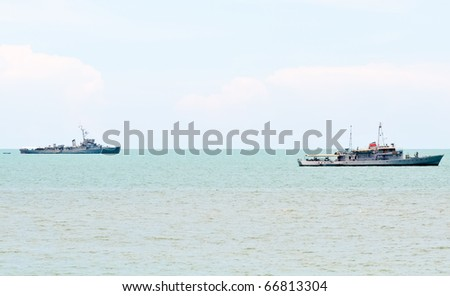 Couple of old warship in the blue sea - stock photo