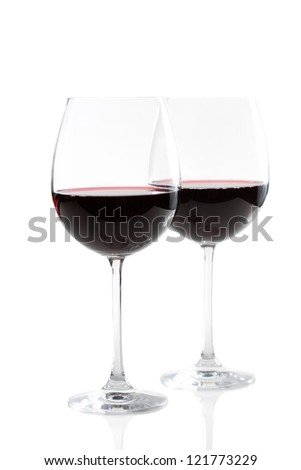 Couple of red wine glasses isolated on white - stock photo