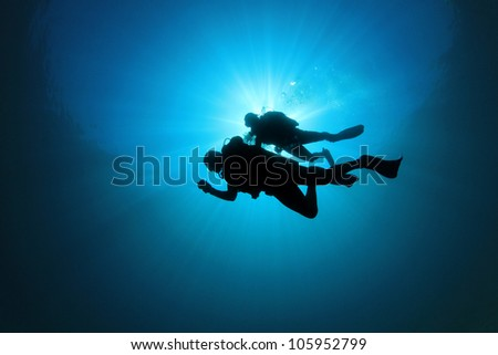 Couple of Scuba Divers Underwater - stock photo