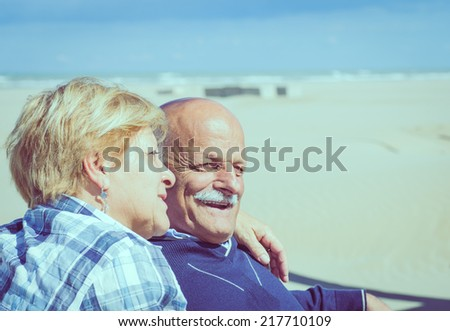 couple of seniors on the beach