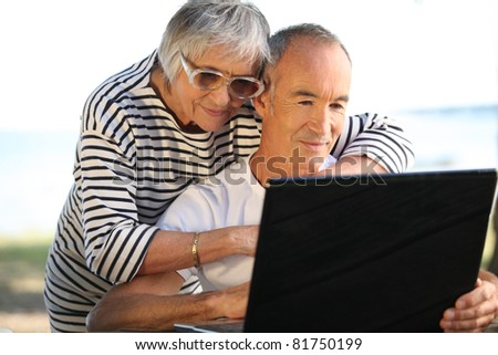 couple of seniors outdoors - stock photo