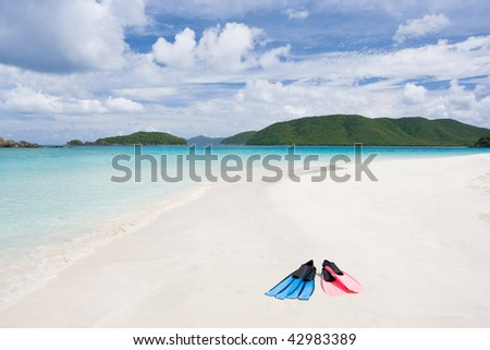 couple of snorkel flippers on tropical beach in caribbean