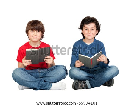 Couple of student children with a book isolated over white background - stock photo