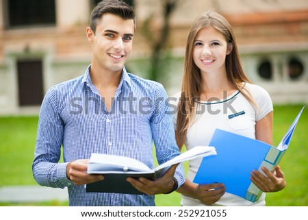 Couple of students at the park - stock photo