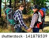 Couple of tourists follow the trekking trail. - stock photo