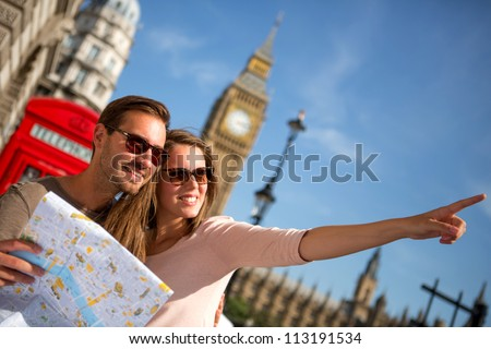 Couple of tourists in London holding a map