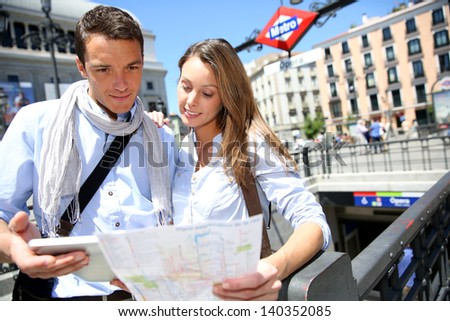 Couple of tourists in Madrid at subway entrance - stock photo