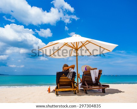 Couple of tourists on the beach in Bali