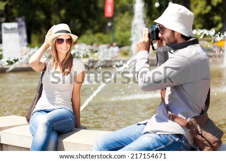 Couple of tourists taking a photo - stock photo