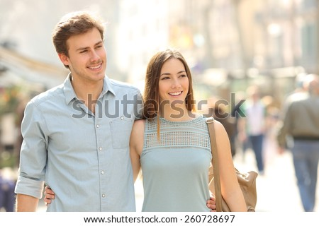 [fb] les angélus // jola&monsiame Stock-photo-couple-of-tourists-taking-a-walk-in-a-city-street-sidewalk-in-a-sunny-day-260728697