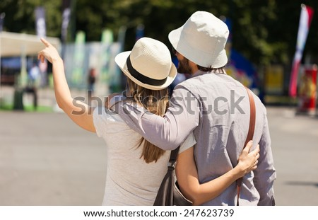 Couple of tourists walking in a city - stock photo