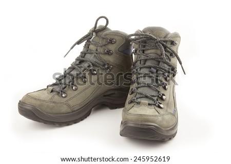 Couple of trekking new shoes isolated on white - stock photo
