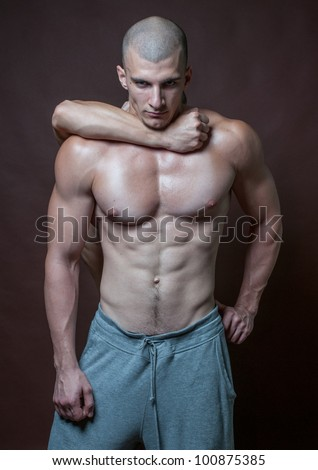 Couple of two model one is choking another in a friendly hug - stock photo