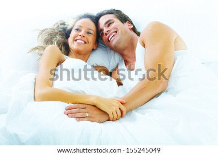 Couple of two young people in bed