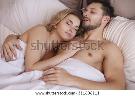 Couple of young adults sleeping in the bedroom