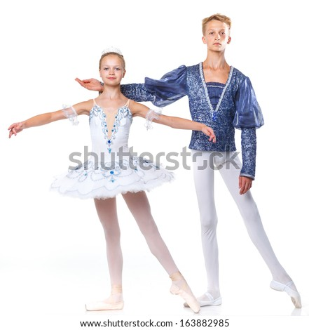 Couple of young ballet dancers posing over isolated white background - stock photo